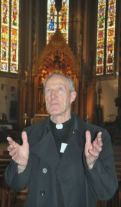 Canon Edward Stewart, showing delegates around St Chad's Roman Catholic Cathedral